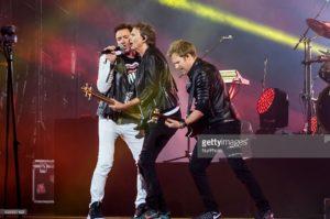 Simon Le Bon, John Taylor e Dom Brown sul palco dell'Arena